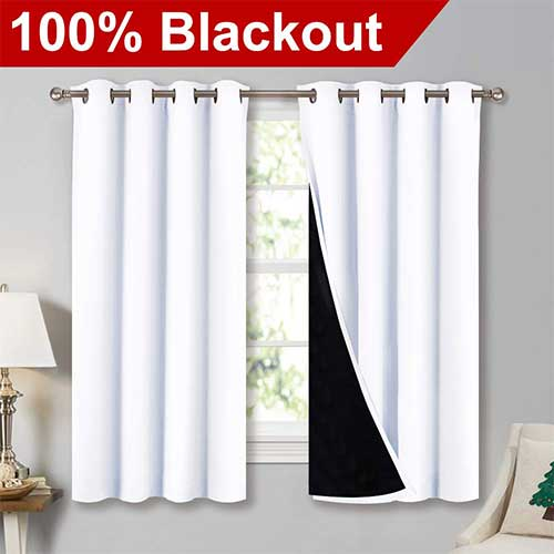 3. NICETOWN White 100% Blackout Lined Curtains, 2 Thick Layers Completely Blackout Window Treatment Thermal Insulated Drapes